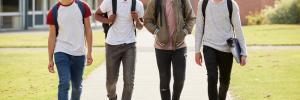 teen boys walk to school