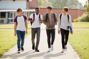 teen boys walk to school